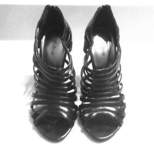 Size 5.5 Diba caged stilettos.